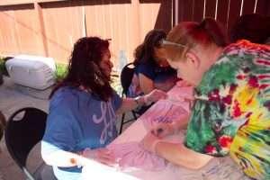 High Tie Dye Party -- folding shirts, pre dye.